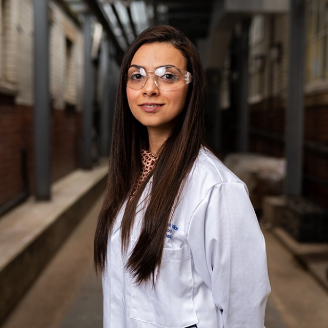 A person in a lab coat and glasses